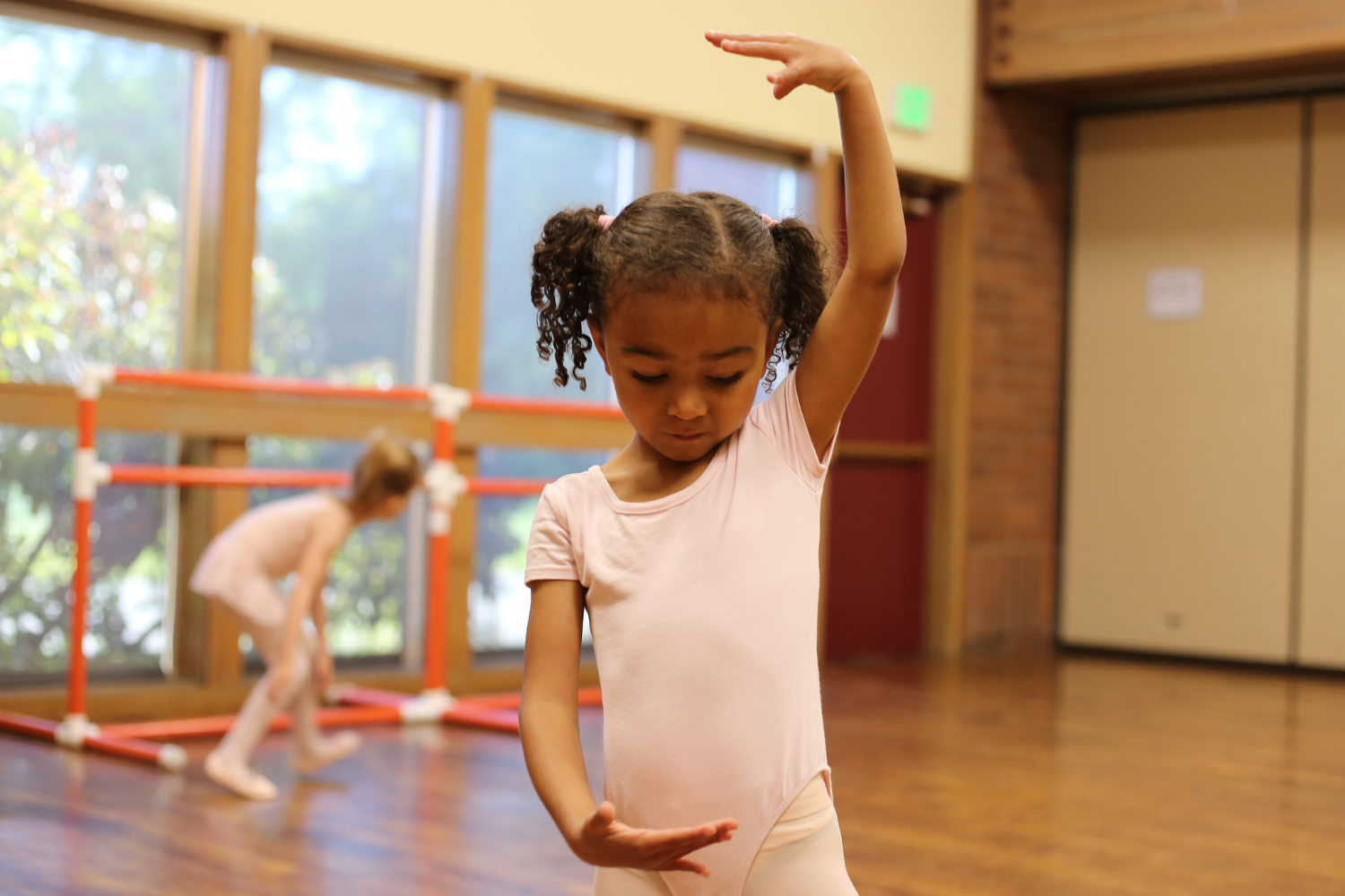 little girl in beginning ballet class