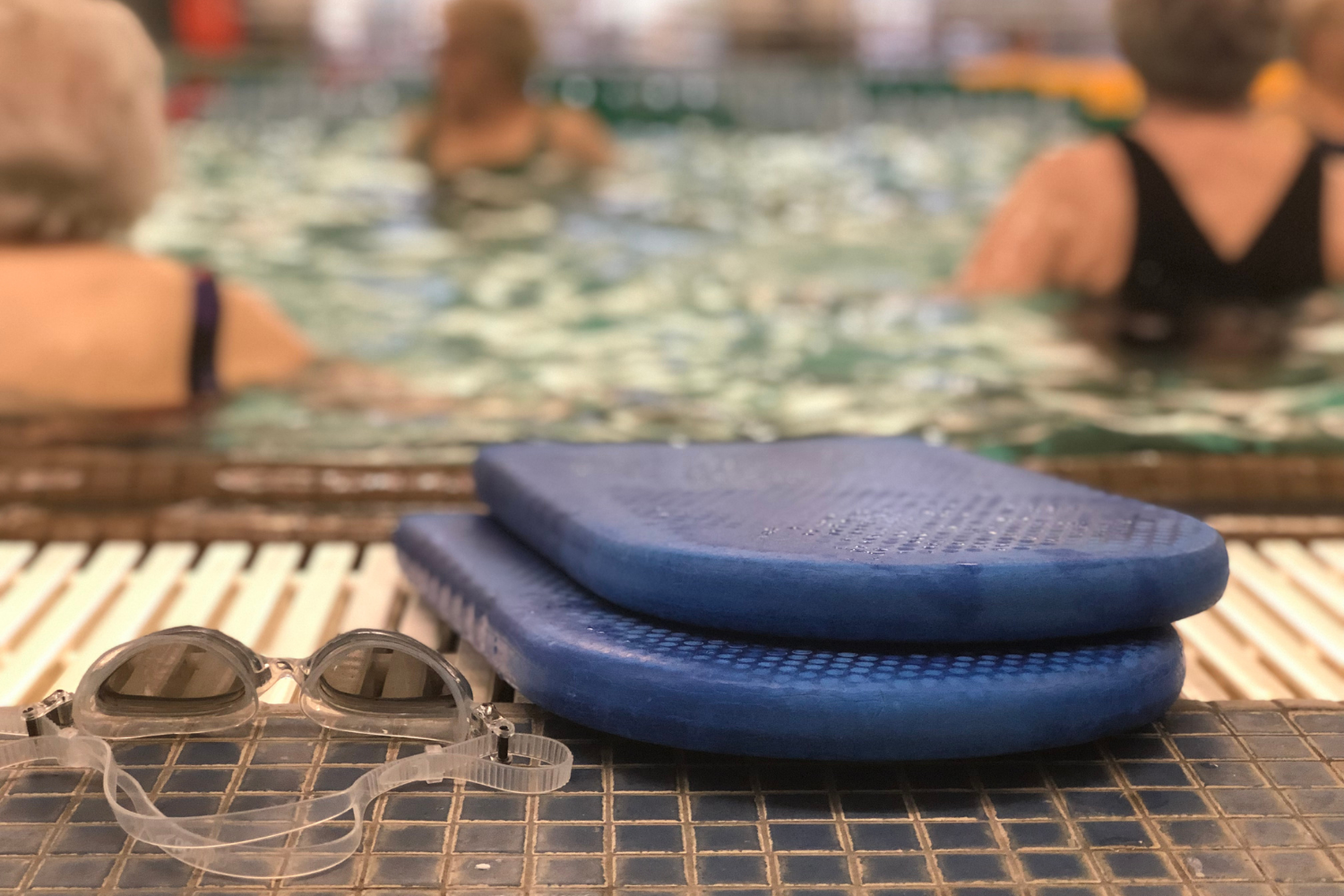 kickboards and goggles for senior water aerobics class