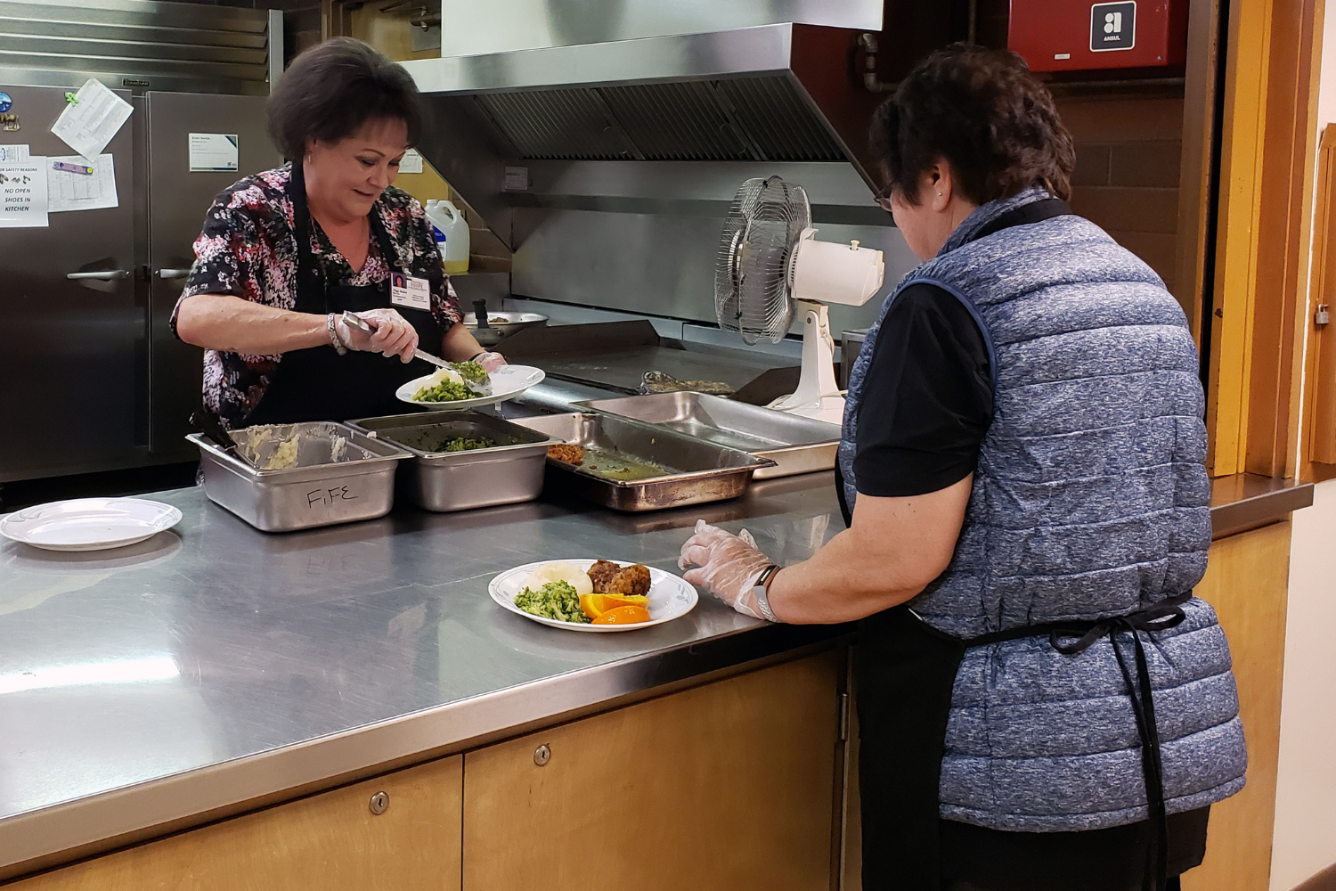 preparing lunch for seniors at Fife Community Center